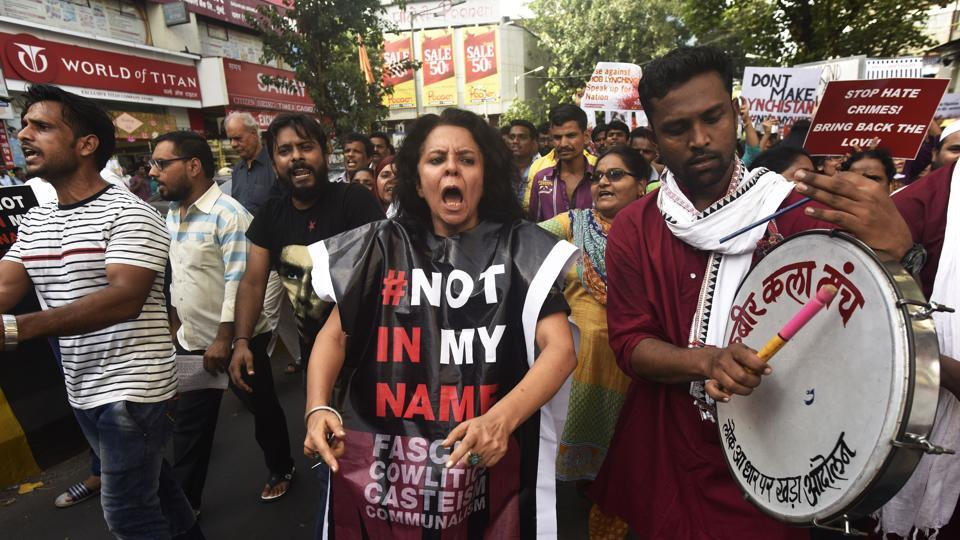 People participate in the rally at Dadar in Mumbai on Monday.
