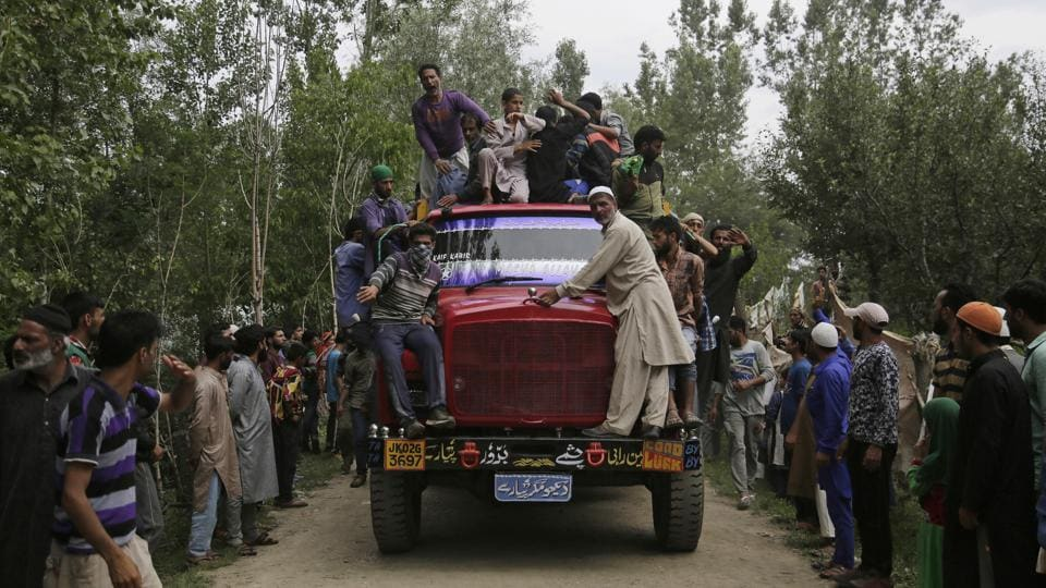 Villagers carry the body of killed rebel Jehinger Ahmad in a truck during his funeral at Keller, 49 kilometers south of Srinagar, on July 4.