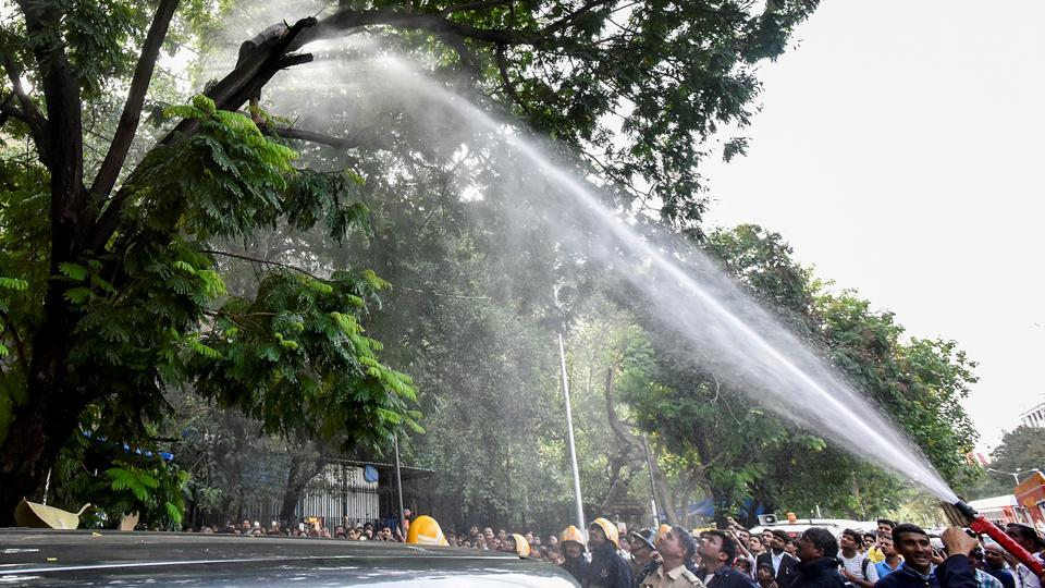 A water canon being used to get her down. (Kunal Patil/HT Photo)