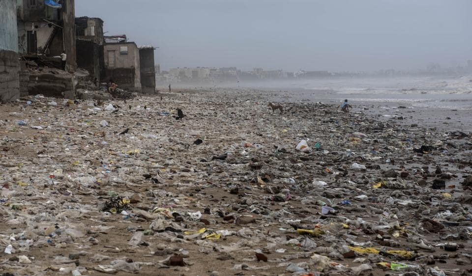 Filth washed ashore on Versova beach in Mumbai on Monday.