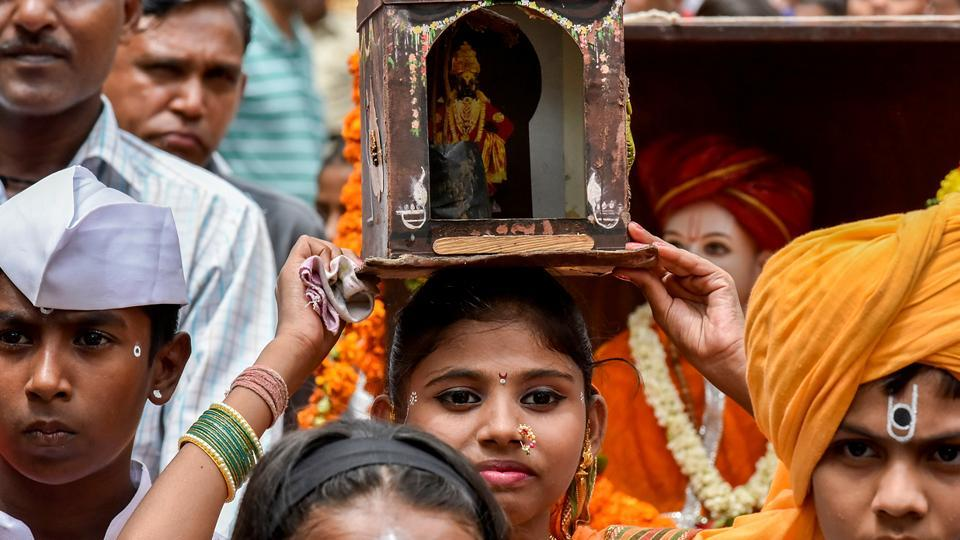 Devotees of Vitthal take part in a Wari procession on the occasion of Ashadhi Ekadashi at Wadala in Mumbai.On this day, Warkaris, or devotees of the Lord, head to Pandharpur. It is considered Maharashtra's biggest annual pilgrimage held in the Hindu month of Aashaadh around June-July. The Warkaris believe that Lord Vitthal awaits them at the end of this walk, and see the journey itself as the reward. (Kunal Patil/HT Photo)