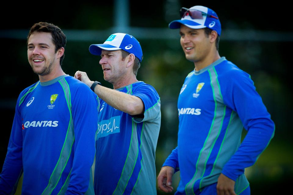 Members of the Australia A squad Travis Head (L), Nathan Weller and Alex Carey (R) take part in a cricket training session at Allan Border Field in Brisbane on July 4.