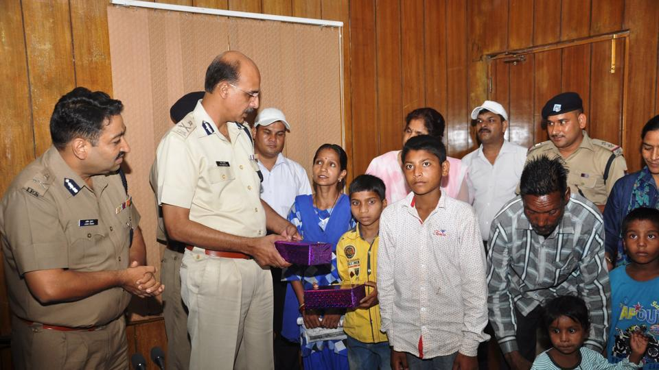Director General of Police MA Ganpathy with some of the rescued children, in Dehradu on  Tuesday.