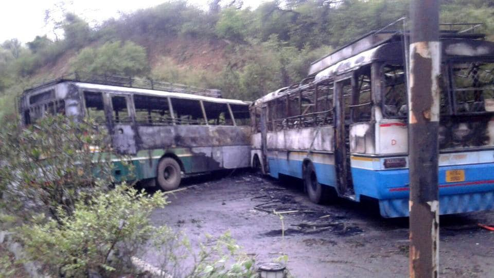 Two buses caught fire after collision at Damtal in Kangra district on Tuesday.