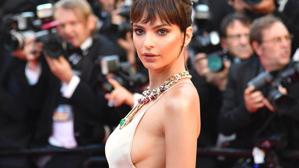 Emily Ratajkowski poses as she arrives for the screening of the film Ismael's Ghosts (Les Fantomes d'Ismael) during the opening ceremony of the 70th edition of the Cannes Film Festival in Cannes.