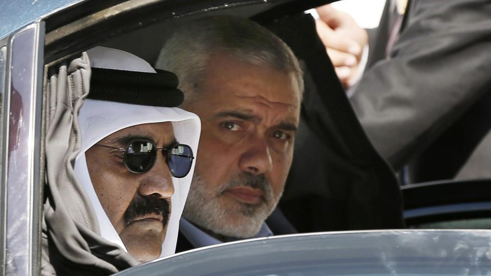 Former Emir of Qatar Sheikh Hamad bin Khalifa al-Thani (L), and Gaza's Hamas prime minister Ismail Haniyeh, arrive for a corner-stone laying ceremony for Hamad, a new residential neighborhood in Khan Younis, Gaza. Qatar has invested hundreds of millions of dollars in infrastructure in Hamas-ruled Gaza, but its role as one of the few foreign backers of the internationally shunned Islamic militant group could is a major issue of contention as Qatar faces pressure from its Gulf neighbours to cut these ties. (Mohammed Salem / AP File)