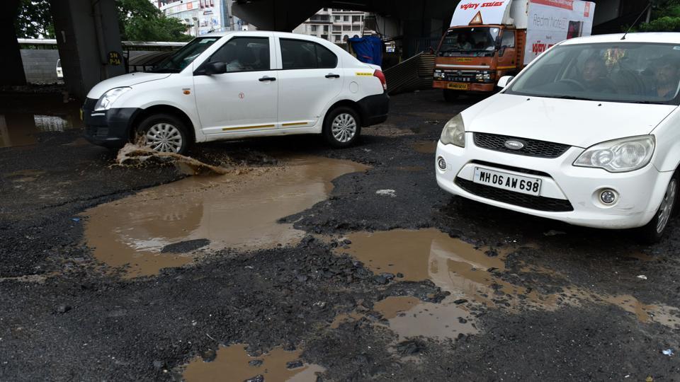 Potholes at Sion Panvel highway near Kharghar, Navi Mumbai, June 29 (Bachchan Kumar/HT)