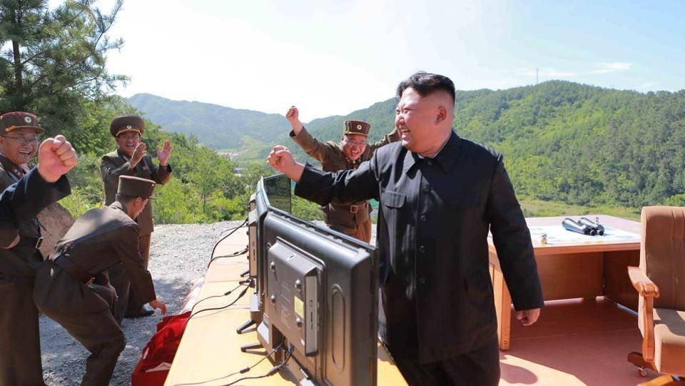 North Korean Leader Kim Jong Un reacts during the test-fire of intercontinental ballistic missile.  (REUTERS)