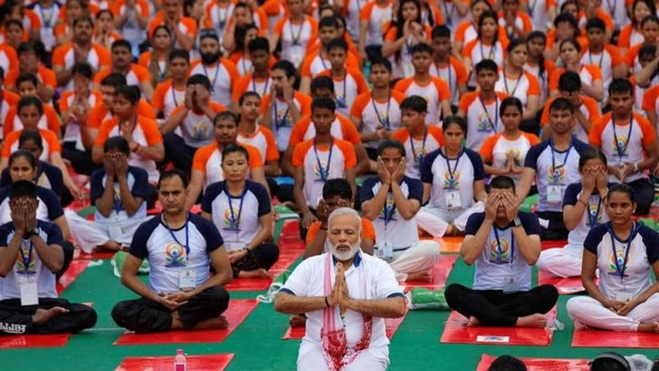 Prime Minister Narendra Modi performs yoga on International Yoga Day in Lucknow on June 21, 2017.