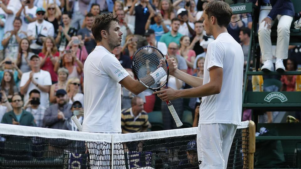 Russia's Daniil Medvedev (R)stunned Switzerland's Stan Wawrinka 6-4, 3-6, 6-4, 6-1 in their first round match at Wimbledon on Monday. (AFP)