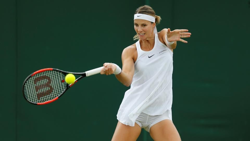 Luxembourg's Mandy Minella in action during her first round match against Italy's Francesca Schiavone at Wimbledon.