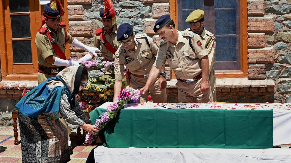CMMehbooba Mufti lays a wreath at the coffin of DSP Mohammed Ayub Pandit during a ceremony at District Police Lines in Srinagar.