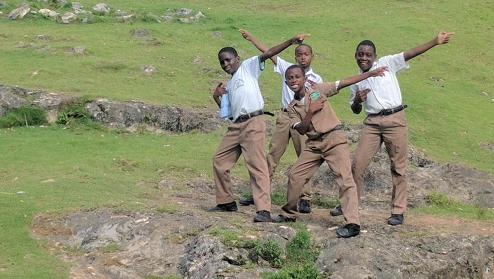 School kids enacting Usain Bolt's celebratory pose in Jamaica. (HT Photo)