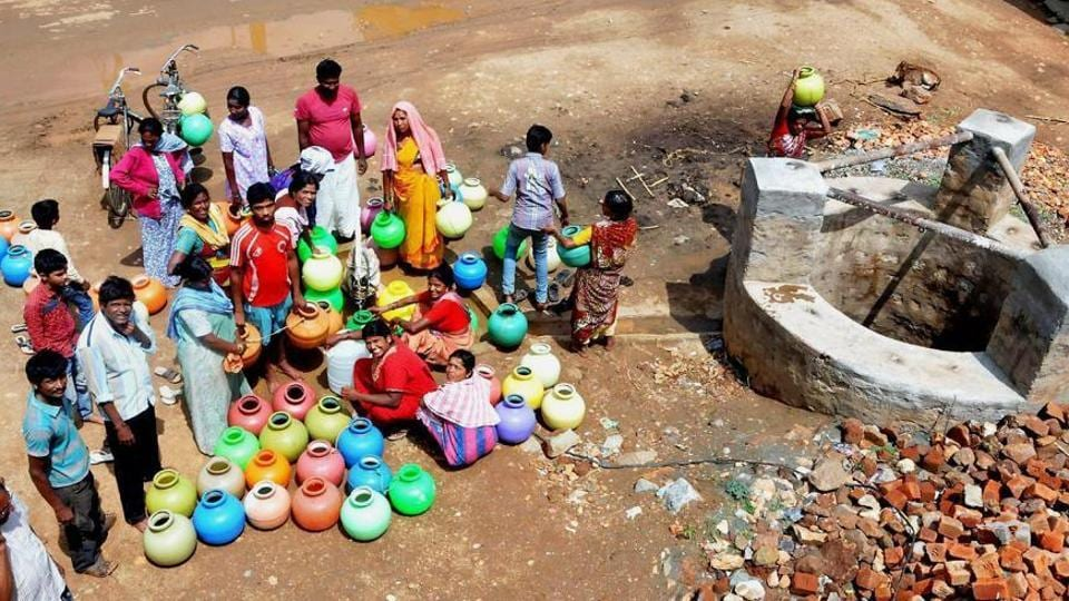 People gather around a well in a drought-hit area in Lakya near Chikmagalur, Karnataka, on June 5.