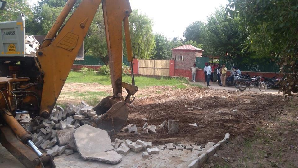 llegal road leading to senior Congress leader Charanjit Singh Channi being demolished by Chandigarh MC staff.