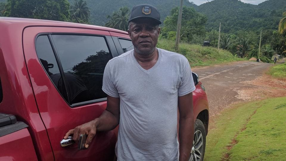 Usain's father Wellesly with his red Toyota Hilux. (Ht Photo)