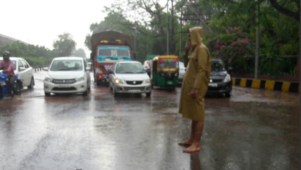 A picture of a cop manning the traffic barefoot at Jharsa was shared on social media recently.