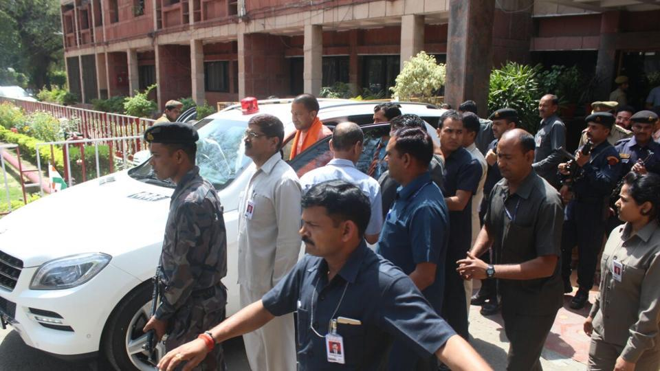 Uttar Pradesh chief minister Yogi Adityanath getting into his official car which he inherited from his predecessor Akhilesh Yadav.
