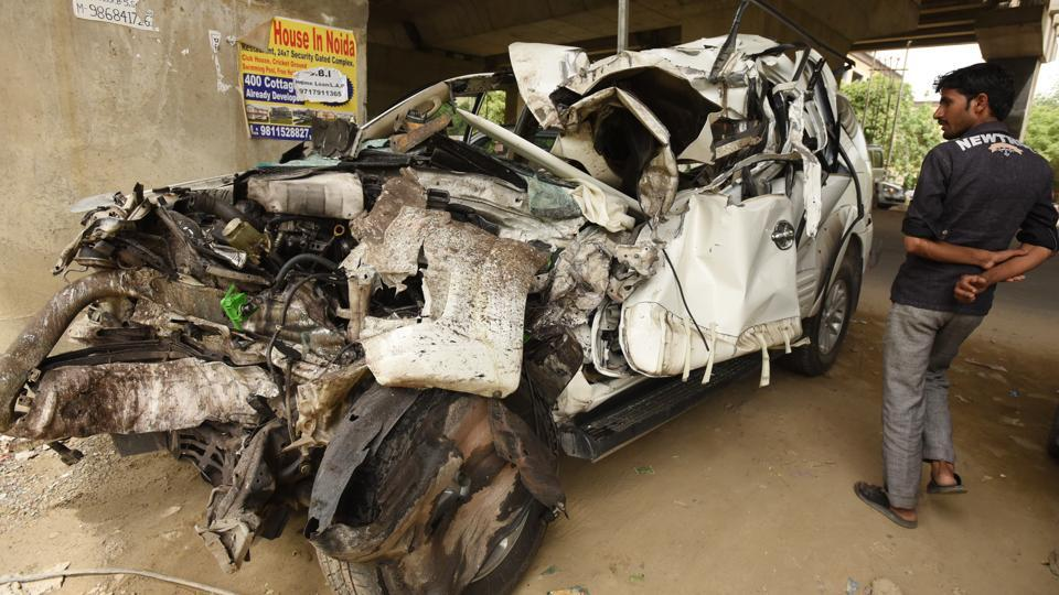 Mangled remains of the Fortuner that hit a dumper on the elevated road in Noida.