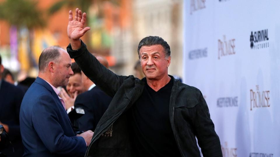 Sylvester Stallone waves at the premiere of The Promise in Los Angeles.