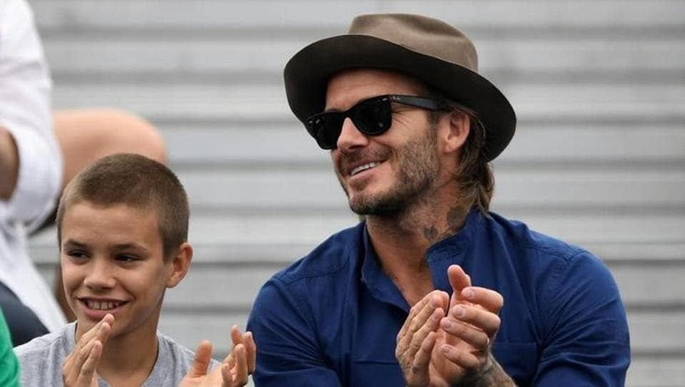 David Beckham's son Romeo (L) is an avid tennis fan.