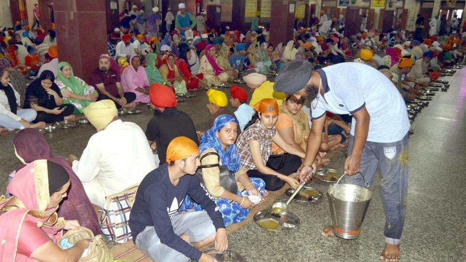 Devotees partaking of langar at the Golden Temple in Amritsar.