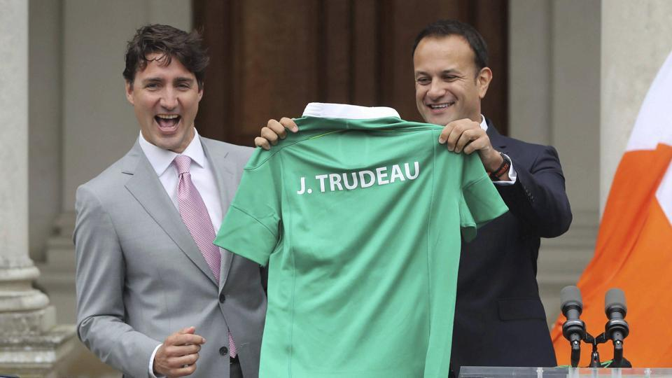 Ireland's Prime Minister Leo Varadkar, right, gives his Canadian counterpart, Justin Trudeau, an Irish themed rugby shirt during a press conference at Farmleigh House in Dublin on July 4.