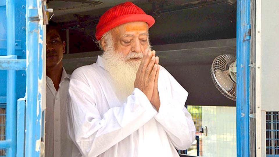 Asaram greets his supporters as he arrives for a hearing at the court in Jodhpur.