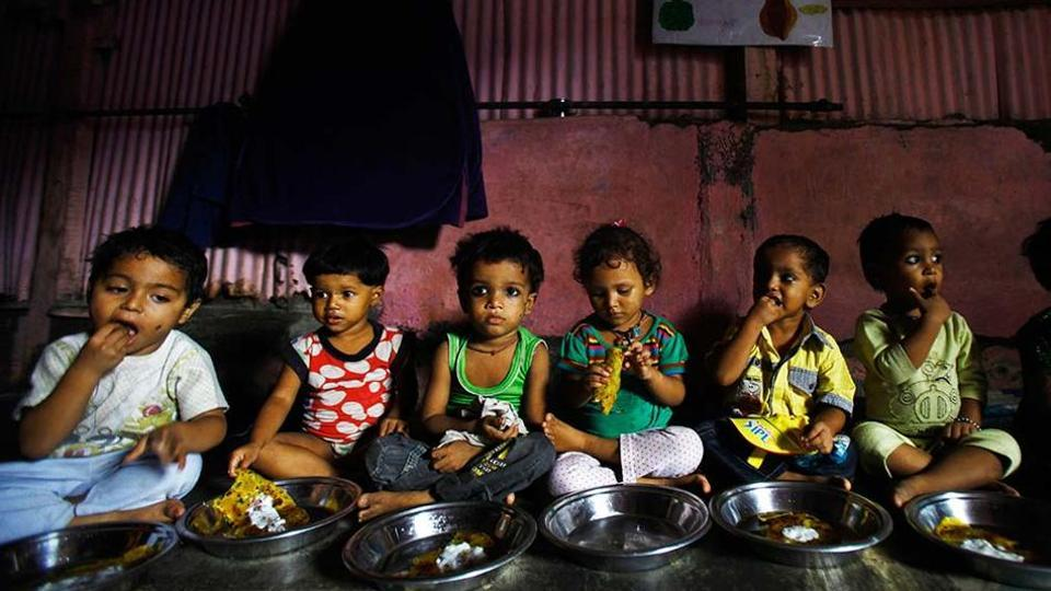 Malnourished children eat at the Apanalaya center, an organisation working for the betterment of slum children, in Mumbai.