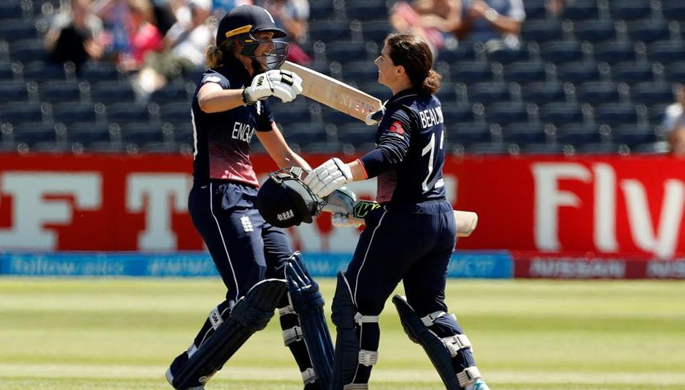 England's Tammy Beaumont (R) celebrates her century with Sarah Taylor during an ICCWomen's World Cup match. Catch full cricket score of England vs SouthAfrica ICC Women's World Cup match here.