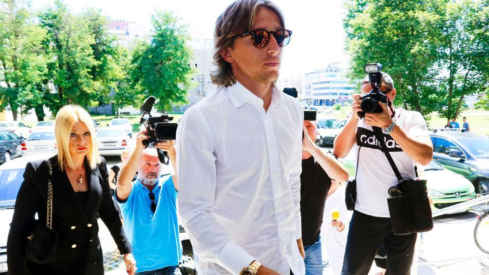 Real Madrid's midfielder Luka Modric (C) accompanied by a lawyer, arrived at the State Attorney's Office in Osjek.