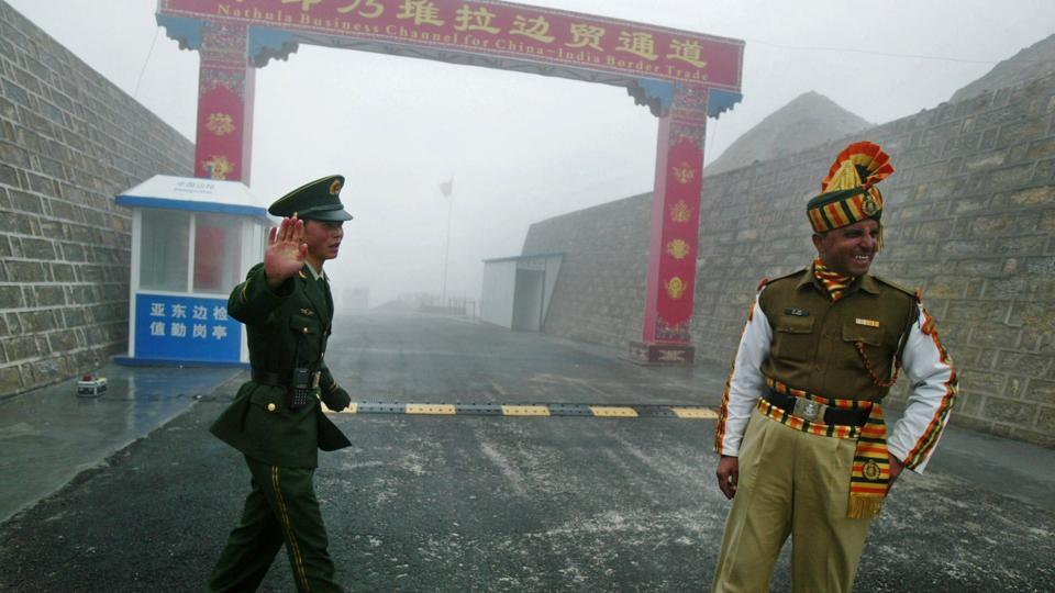 A photograph from July 10, 2008, shows a Chinese soldier (left) and an Indian soldier standing guard at the Chinese side of the Nathu La border crossing between India and China.
