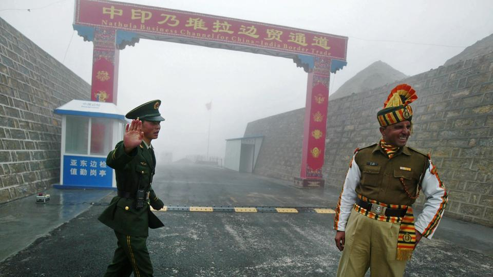 This file photo shows a Chinese soldier next to an Indian soldier at the Nathu La border crossing between India and China in Sikkim.