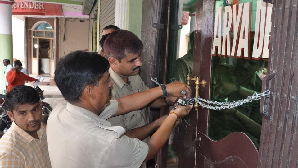 Officials said that the two hotels, Devender and Aryadeep, were sealed following raids in March but they were found operating and the official seals were broken.