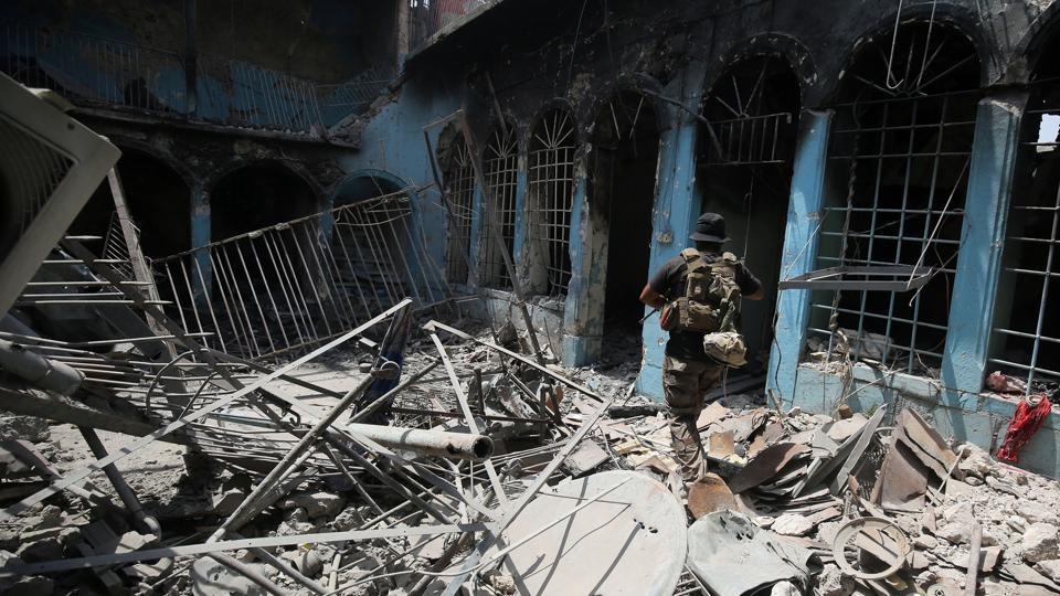 Damaged and destroyed houses dot the areas retaken by Iraqi forces and the stench of rotting bodies rises from beneath collapsed buildings.  (AFP)