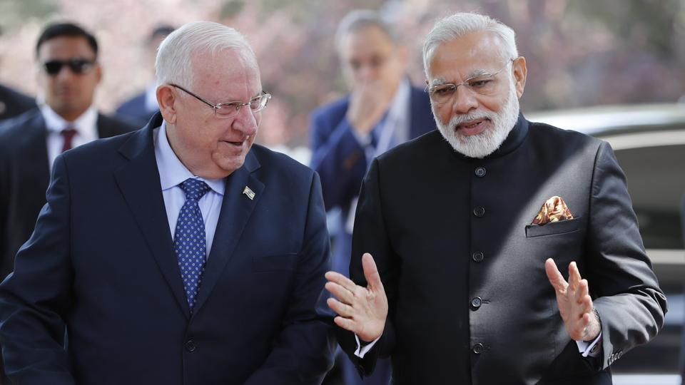 Israeli President Reuven Rivlin (left) chats with Prime Minister Narendra Modi during a welcome ceremony at the president's official residence in Jerusalem.