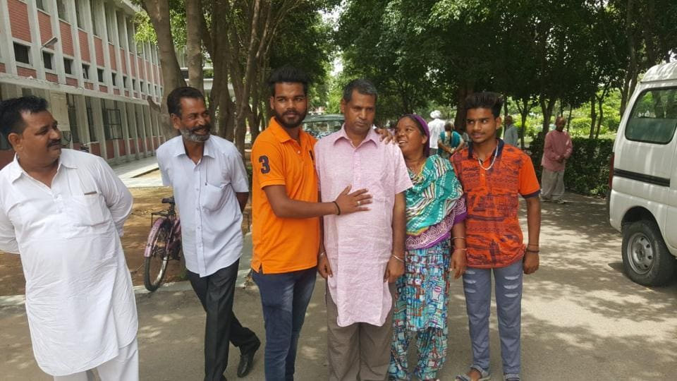 Suresh Kumar with his family members at Jalandhar on Wednesday.