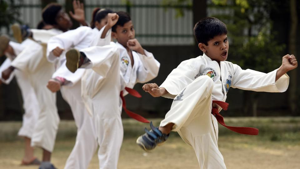 A Taekwondo student practices at Shanti Niketan Park in New Delhi. For many taekwondo is an art that implies a way of thinking and life. Considered one of the most effective means in developing and enhancing perpetual emotional and psychological characteristics in younger generation, experts from the field have often come forward saying it teaches self-care and discipline which becomes extremely beneficial for the students in the future.  (Sonu Mehta/HT PHOTO)