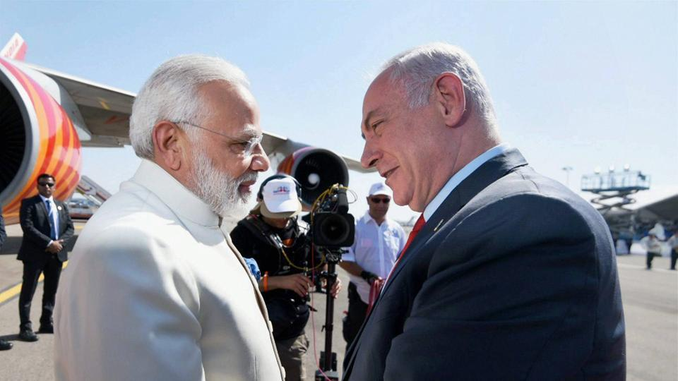 Prime Minister, Narendra Modi being received by the Prime Minister of Israel, Benjamin Netanyahu, on his arrival, at Ben Gurion Airport, in Tel Aviv on Tuesday.
