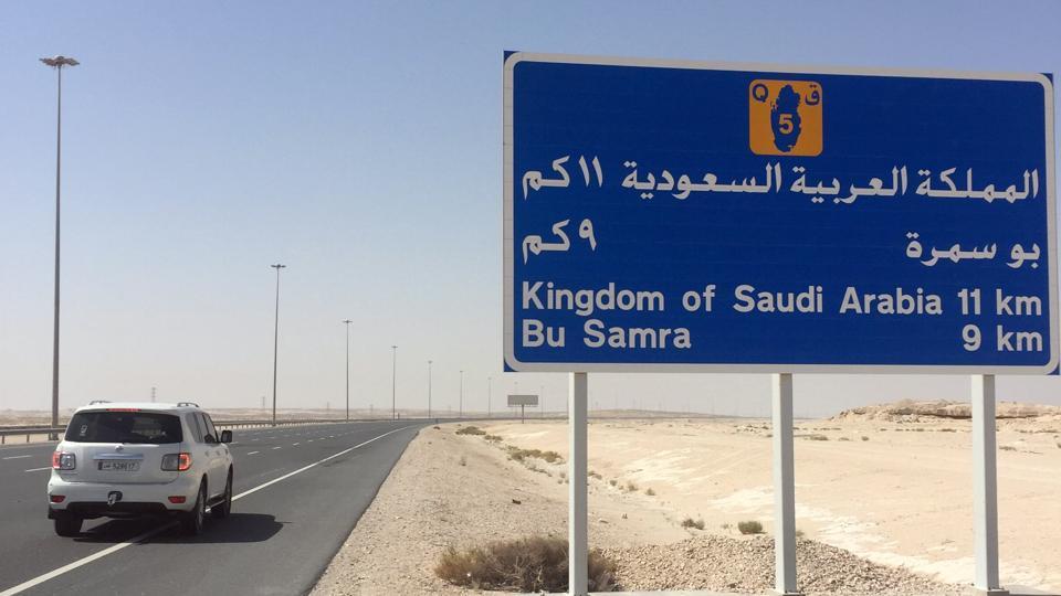 A road sign is seen near Abu Samra border crossing to Saudi Arabia, Qatar.