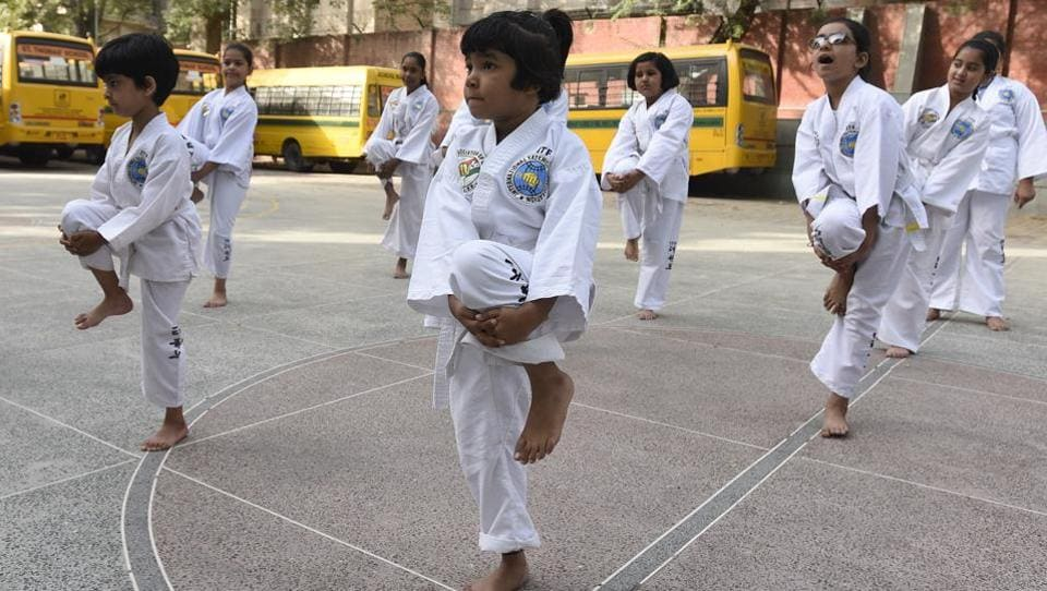 Various colours of belts signify the maturity and proficiency in taekwondo with white signifying a 'beginner' level. (Sonu Mehta/HT PHOTO)