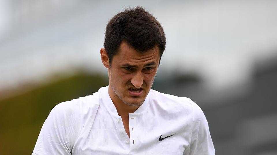Australia's Bernard Tomic reacts during his Wimbledon men's singles first round match against Germany's Mischa Zverev.