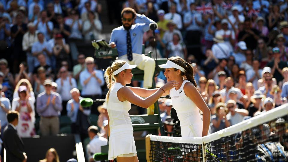 Johanna Konta shakes hands with Donna Vekic after winning their second round match at Wimbledon.