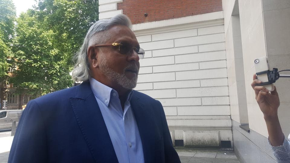 Vijay Mallya arrives at the Westminster Magistrates Court in London for a hearing in his extradition case.