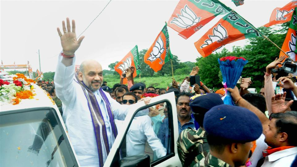 BJP president Amit Shah waves at supporters as they welcome him on his arrival at Basantapur village on the outskrits of Bhubaneswar on July 6.