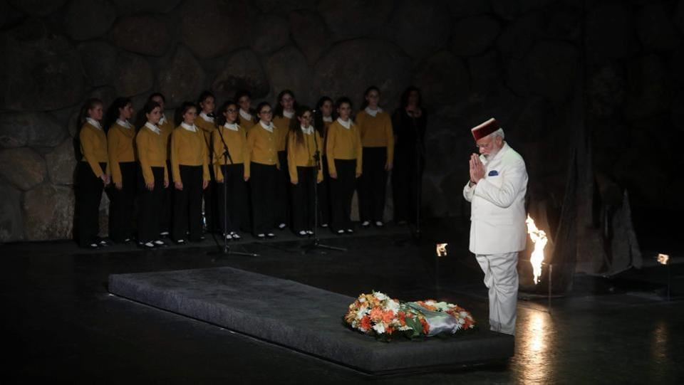 Prime Minister Narendra Modi paid respects during a visit to Yad Vashem Holocaust Memorial where he rekindled the Eternal Flame and also visited the Hall of Names in Jerusalem, Israel. (AP)