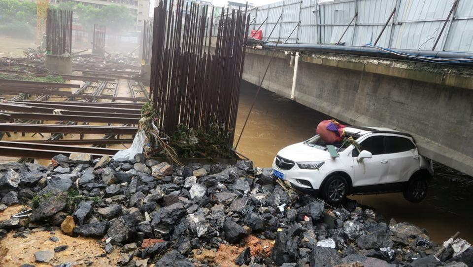 A damaged car is seen under a bridge after a flood in Quanzhou County, in Guilin, Guangxi province. (REUTERS)