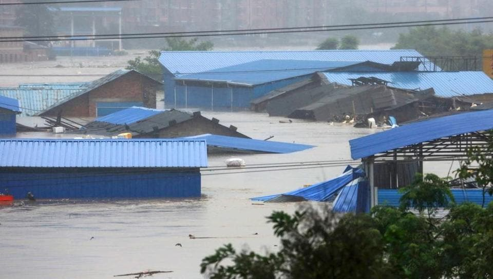 A general view shows a flooded area in Loudi, Hunan province. At least 56 people have been killed and 22 others missing as heavy rains left a trail of destruction in 11 Chinese provinces. A total of 27,000 houses were collapsed and 37,000 others damaged in floods, landslides and hailstorms since June 29. According to Xinhua news agency the government allocated 1.88 billion yuan (USD 270 million) to 20 provinces for disaster relief. (AFP)
