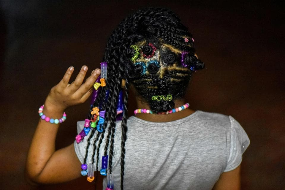 While slavery was abolished in Colombia on May 21, 1851, many were still mistreated and forced to forgo African traditions, such as braiding. (LUIS ROBAYO / AFP)