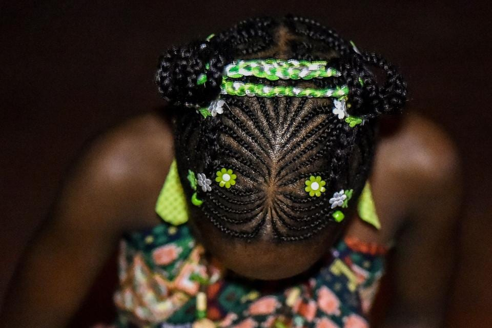 The category of children's hairstyles had abundance of colourful and fun hairbraids. (LUIS ROBAYO / AFP)